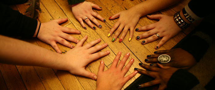 Family Solutions Girls Home Residents Placing Hands on Table in an Act of Solidarity and Support