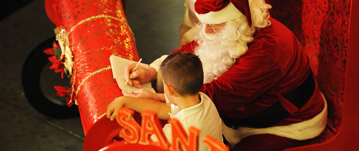 Rogue Winterfest Weekend Holiday Events: Santa Signing Letter to Boy