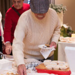 Rogue Winterfest 2016 Golden Social Man with Hat at Buffet
