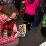 Rogue Winterfest 2016 Weekend Holiday Events Father and Son with Book