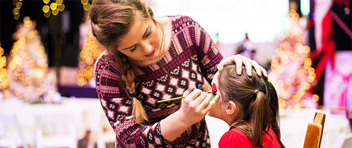 Face-Painting a Young Girl